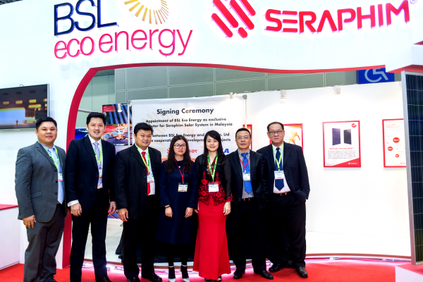 Celebrating the partnerships with a 'family' picture! (From left) BSL Eco Energy directors Mr Andy Woo and Mr Adrian Goh, BSL Eco Energy Managing Director Mr Lim Chi Haur, TBEA Co Ltd Regional Director (SEA) International Marketing Management Ms He Shaofang, BSL Eco Energy Communications Director Ms Irene Tan, TBEA Co Ltd Deputy General Manager for International Business Mr Chen Jie and BSL Eco Energy director Mr Jimmy Teh